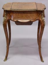 A GOOD 19TH CENTURY FIGURED WALNUT AND ORMOLU SEWING TABLE, possibly by Gillow, with rising top revealing a mirror and lift out tray, flanked by storage compartments above a sliding wool box, supported on slender cabriole legs. <br>1ft 10ins wide x 1ft 4ins deep x 2ft 4ins high.