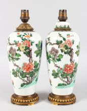 A PAIR OF SAMSON OF PARIS FAMILLE VERTE PORCELAIN VASES converted to lamps with ormolu mounts. <br>10ins high.