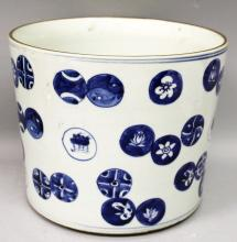 A LARGE CHINESE BLUE & WHITE PORCELAIN BRUSHPOT, painted with a variety of overlapping roundels, the base unglazed, 9.6in diameter at rim & 7.8in high.