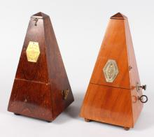 TWO FRENCH WOODEN CASED METRONOMES. <br>9ins high.