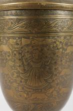 A 19TH CENTURY INDIAN OR BURMESE BRASS POT AND COVER, engraved with figures and lion. <br>14ins high.