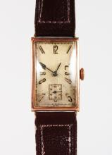 A GENTLEMAN'S 1930'S 9CT GOLD WRISTWATCH AND LEATHER STRAP.