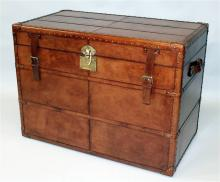 A GOOD LARGE LEATHER TRUNK, with interior removabl