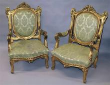 A PAIR OF LOUIS XV STYLE GILT FRAMED ARMCHAIRS, wi