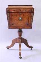 A REGENCY ROSEWOOD TEAPOY with rising top and fitt