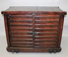A JAPANESE PINE & ELM CABINET, the ribbed sliding