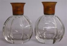 A PAIR OF HEAVY SCENT BOTTLES with tortoiseshell t