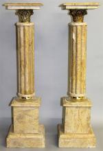 A PAIR OF CREAM MARBLE PEDESTALS with cluster colu