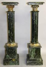 A PAIR OF GREEN MARBLE PEDESTALS with cluster colu