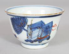 A CHINESE KANGXI PERIOD BLUE & WHITE PORCELAIN TEABOWL, some details in iron-red, 2.3in diameter & 1.5in high.