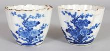 A PAIR OF 18TH CENTURY CHINESE BLUE & WHITE SOFT PASTE FLUTED PORCELAIN TEABOWLS, decorated with quail and foliage, 2.5in diameter & 2in high.