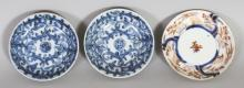 A PAIR OF 18TH CENTURY CHINESE BLUE & WHITE PROVINCIAL PORCELAIN SAUCERS, 3.5in diameter; and an 18th Century Japanese Imari porcelain saucer, 3.75in diameter. (3)