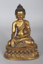 A GOOD QUALITY 18TH/19TH CENTURY TIBETAN GILT BRONZE FIGURE OF BUDDHA, weighing approx. 660gm, the Buddha seated in dhyanasana on a double lotus plinth, his hands in avakasha and bhumisparsha mudra, 5.5in high.