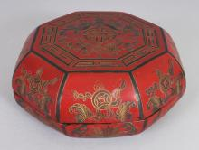 A 20TH CENTURY CHINESE MING STYLE OCTAGONAL LACQUER BOX & COVER, 5.25in wide & 2.4in high.