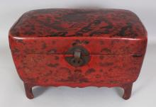 AN UNUSUAL 19TH/20TH CENTURY CHINESE RED LACQUERED BOX ON STAND, of rectangular form with rounded corners, the hinged cover decorated with phoenix, rockwork and <br>peony, 18.5in wide x 12in deep x 12in high.