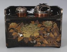 A GOOD JAPANESE MEIJI PERIOD TOBAKOBON, the two coppered containers with good quality butterfly pierced silver-metal covers, the sides and drawers finely decorated in various gold lacquer techniques with peony, leafage and rockwork, 8.4in x 4.8in x 6.75in high.