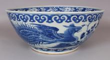 A GOOD LARGE 19TH CENTURY CHINESE BLUE & WHITE PORCELAIN PHOENIX BOWL, the sides painted with peony and two confronting phoenix, 15.3in diameter & 6.5in high.