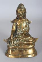 A BURMESE BRONZE BUDDHA, 19th Century or earlier, the Buddha with inlaid glass eyes, 4in wide & 6.1in high.