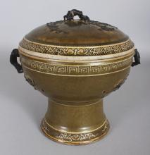 AN UNUSUAL 19TH CENTURY CHINESE TEA DUST GLAZED FOOTED BOWL & COVER, with moulded brown dressed handles and sprigs of prunus. 7.6in diameter at rim & 8.5in high overall.