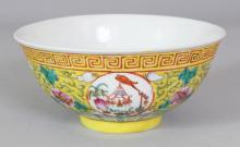 A 19TH/20TH CENTURY CHINESE YELLOW GROUND PORCELAIN MEDALLION BOWL, the base with a six-character Guangxu mark, 5.5in diameter & 2.5in high.