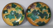 A GOOD LARGE PAIR OF 19TH CENTURY JAPANESE YELLOW GROUND AO KUTANI PORCELAIN DISHES, each painted with paulownia leaves, each base with a Kutani mark, 14.25in diameter.