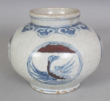 AN 18TH/19TH CENTURY KOREAN COPPER-RED & UNDERGLAZE-BLUE PORCELAIN PHOENIX VASE, the shoulders with a ruyi border, 5.9in wide at widest point & 4.8in high.