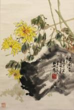 A 20TH CENTURY CHINESE HANGING SCROLL PAINTING ON PAPER, depicting yellow flowers, leafage and rockwork, the painting itself approx. 26.5in x 17.75in.