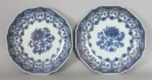 A PAIR OF EARLY 18TH CENTURY CHINESE BLUE & WHITE PORCELAIN DISHES, of octagonal form with indented corners, 8.4in diameter.