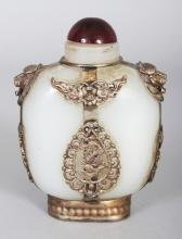 A CHINESE SILVER-METAL OVERLAID WHITE JADE-LIKE GLASS SNUFF BOTTLE & STOPPER, 3.5in high.