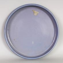 AN UNUSUAL 20TH CENTURY CHINESE BLUE GLAZED SHALLOW BOWL, the unglazed base impressed with a seal mark, 13.1in diameter & 1.8in high.