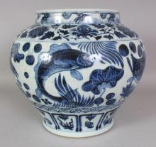 A LARGE CHINESE YUAN STYLE BLUE & WHITE PORCELAIN CARP JAR, the base unglazed, 13.25in wide at widest point & 11.7in high.