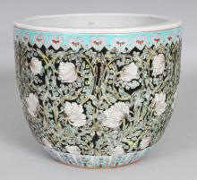 AN EARLY 20TH CENTURY CHINESE ART NOUVEAU STYLE PORCELAIN JARDINIERE, the base unglazed, 8.1in diameter at rim & 6.9in high.