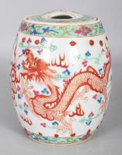 A 20TH CENTURY CHINESE FAMILLE ROSE& ROUGE-DE-FER BARREL-FORM PORCELAIN DRAGON JAR & COVER, the base with a four-character Yongzheng mark, 6.5in high overall.