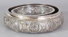 A GOOD EARLY 20TH CENTURY MALAYSIAN SILVER-METAL POSY RING BOWL, the sides embossed with the Federation Armorial and with the Armorials of the Eleven Malay Peninsular States, 8.75in diameter.