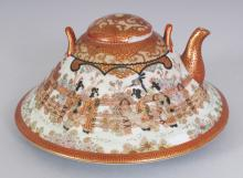 A JAPANESE KUTANI PORCELAIN TEAPOT & COVER, circa 1900, of unusual conical form, the base with a Kutani-sei mark, 6.25in diameter & 3.5in high overall.