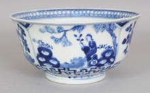 A 19TH CENTURY CHINESE BLUE & WHITE PORCELAIN BOWL, painted with figural and with floral panels, the base with a four-character Kangxi mark, 6.1in diameter & 3in high.