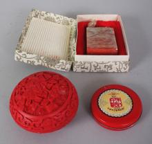 A SMALL CHINESE RED CINNABAR STYLE BOX & COVER, 2.8in diameter; together with a soapstone seal in a fitted fabric covered box, the seal 3in high; and a circular metal box. (3)