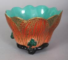 AN IRON-RED & GILT DECORATED MOULDED PORCELAIN LOTUS BOWL, the interior turquoise, the base with a Yongzheng seal mark, 4in diameter & 2.8in high.