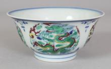 A SMALL CHINESE DOUCAI PORCELAIN DRAGON BOWL, the base with a six-character Yongzheng mark, 4.1in diameter & 1.9in high.