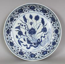 A GOOD QUALITY CHINESE MING STYLE BLUE & WHITE PORCELAIN LOTUS BOUQUET SHALLOW PORCELAIN BOWL, the base unglazed, 12.3in diameter & 2.5in high.