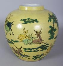 A CHINESE YELLOW GROUND FAMILLE VERTE PORCELAIN '100 DEER' JAR, the base with a six-character mark in underglaze-blue, 7.5in wide at widest point & 7.3in high.