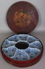 A LATE 19TH/EARLY 20TH CENTURY CHINESE BLUE & WHITE PORCELAIN PART SUPPER SET, in a fitted lacquer wood circular box, the box 18in diameter, each porcelain piece 6.4in x 5.6in at widest points.