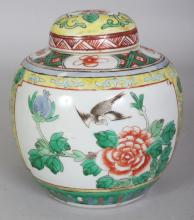 A SMALL EARLY 20TH CENTURY CHINESE FAMILLE VERTE PORCELAIN JAR & COVER, 5.25in wide at widest point & 5.75in high overall.