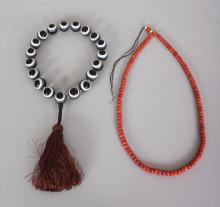 A CORAL NECKLACE, approx 24.5in long; together with a banded agate necklace, each spherical bead 0.75in diameter, the necklace approx. 16in long. (2)