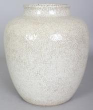 A CHINESE CRACKLEGLAZE PORCELAIN JAR, of ovoid form, 7.75in wide at widest point & 8.75in high.