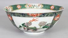 AN EARLY 20TH CENTURY CHINESE KANGXI STYLE FAMILLE VERTE PORCELAIN BOWL, 7.8in diameter & 3.25in high.