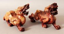 A PAIR OF CHINESE SOAPSTONE STYLE MODELS OF PIXIU MYTHICAL CREATURES, 5.9in long & 3.75in high.