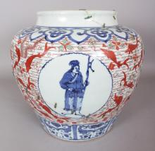 A LARGE CHINESE WANLI STYLE WUCAI PORCELAIN JAR, decorated with figural panels reserved on a ground of fish and water weeds, the base with a six-character Wanli mark, 13.9in wide at widest point & 12.7in high.