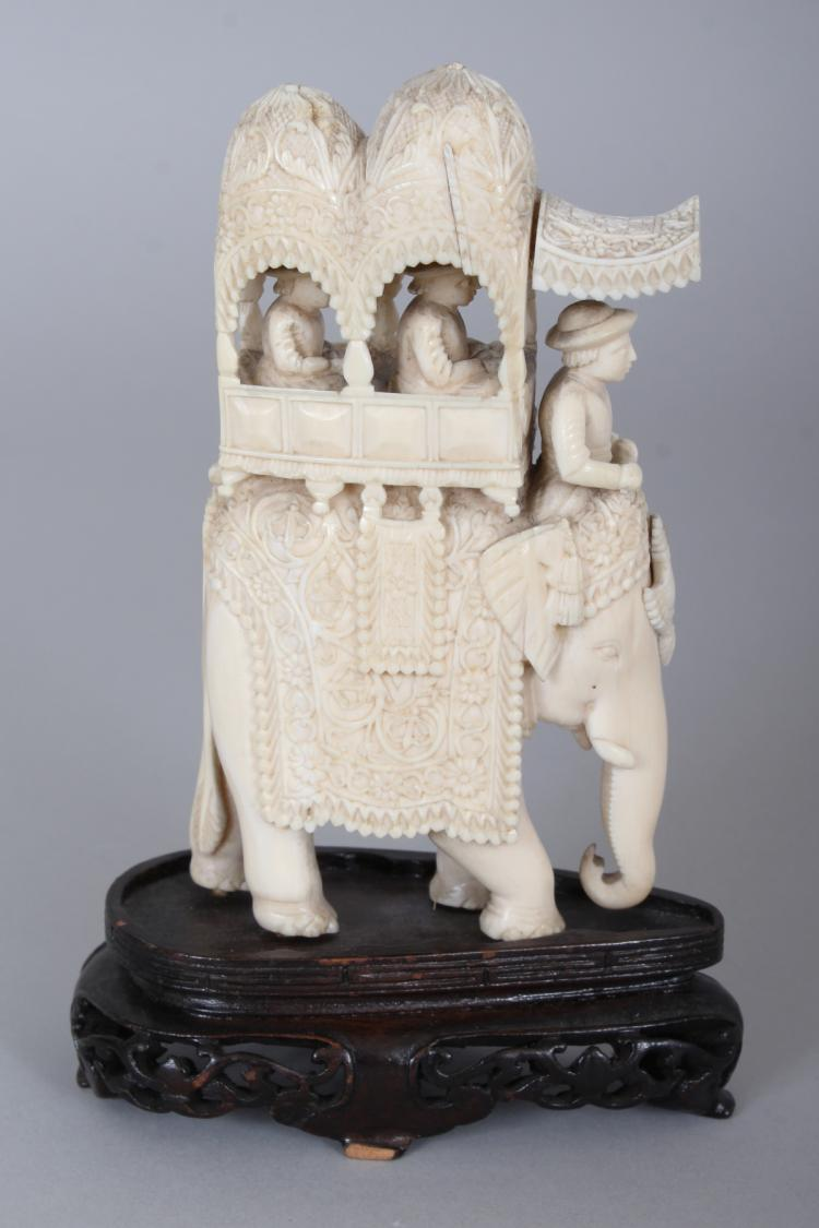 5f84720fe A LATE 19TH EARLY 20TH CENTURY INDIAN IVORY CARVING OF AN ELEPHANT