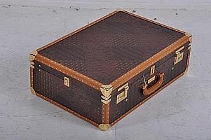 AN ESCADA BRASS BOUND TRUNK complete with